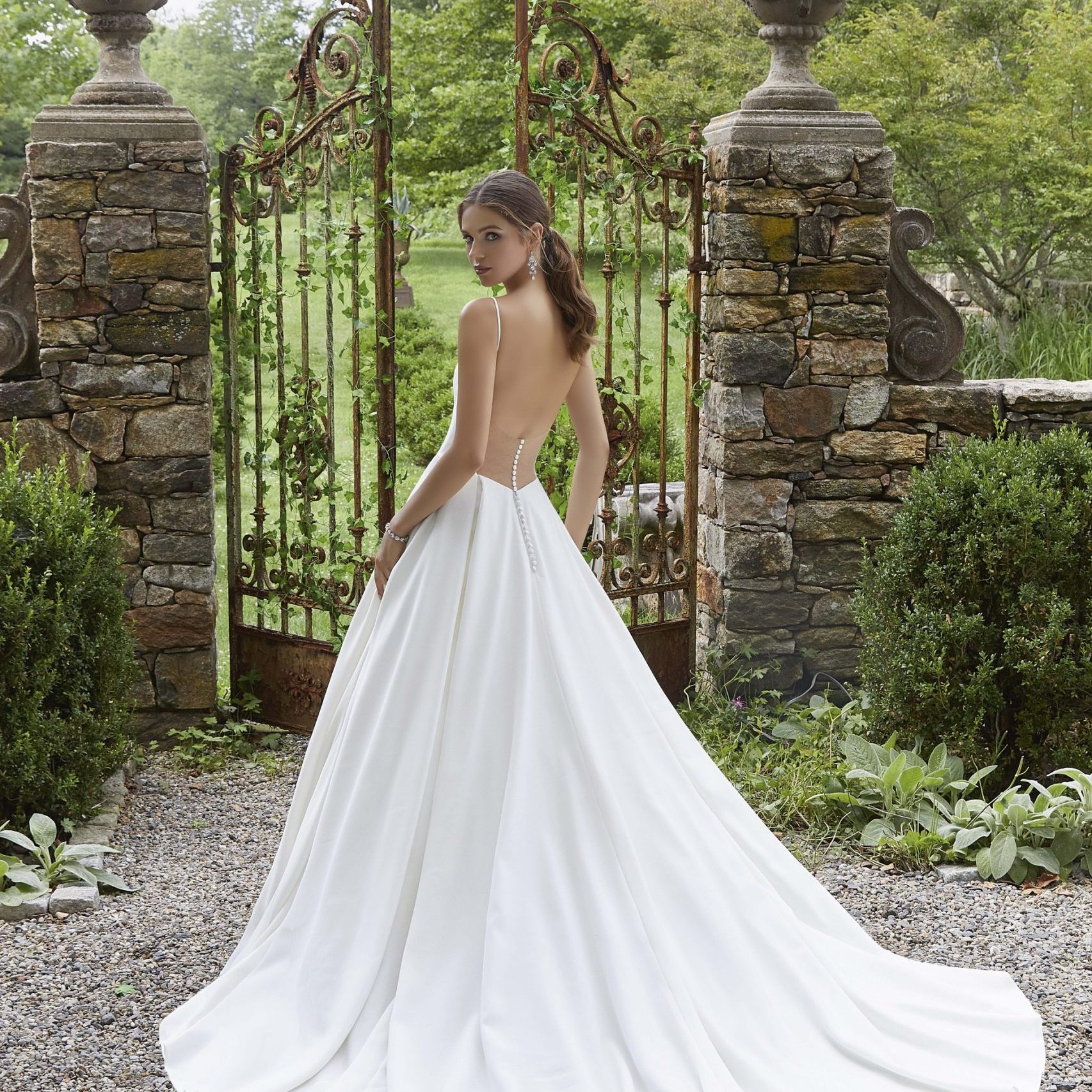 Wedding dress by Morilee at Perfect Day Bridal.