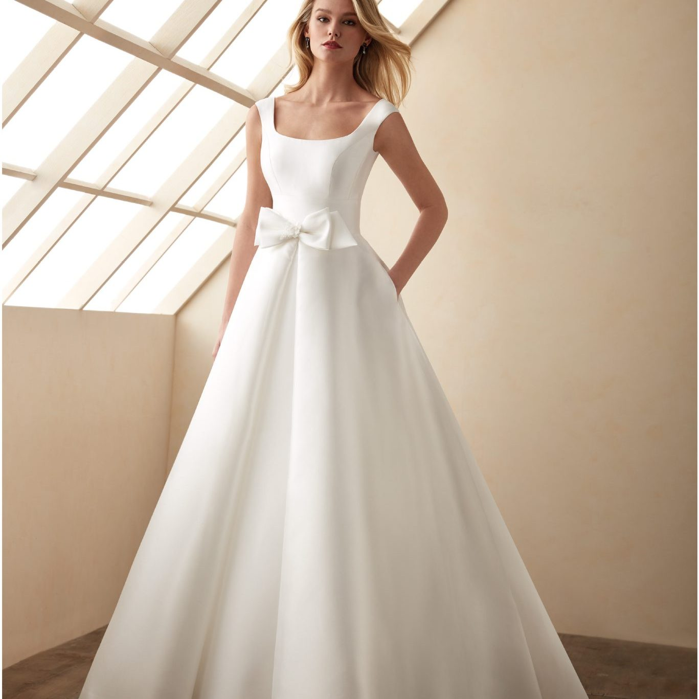 Wedding dress by Valerio Luna for Higar Novias at Perfect Day Bridal.